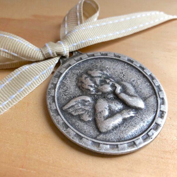 DN-cunero-medalla-angelito-7